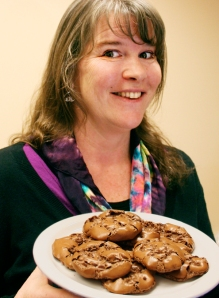 Chantel holding a plate of yummy chocolate cookies made with Dagoba organic and fairly traded cocoa powder.